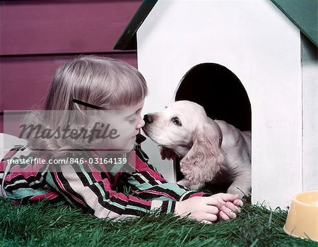 1970s GIRL PUPPY KISS DOG HOUSE Stock Photo - Rights-Managed, Image code: 846-03164139