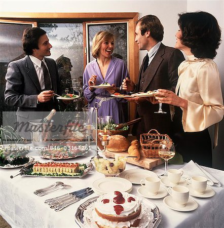 1970s TWO COUPLES SOCIALIZING AT PARTY BUFFET TABLE Stock Photo - Rights-Managed, Image code: 846-03164261