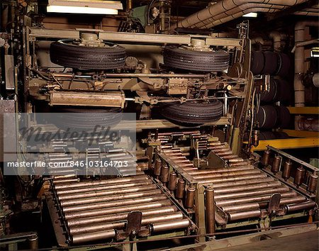 1960s AUTOMOBILE TIRES ON FACTORY ASSEMBLY LINE Stock Photo - Rights-Managed, Image code: 846-03164703