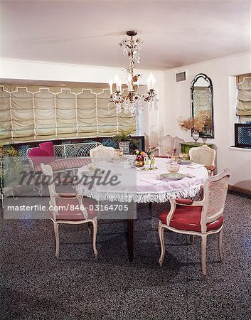 1960s DINING ROOM TABLE CHAIRS PLACES SET FOR FOUR FRINGED TABLECLOTH CHANDELIER AUSTRIAN SHADE WINDOW TREATMENT