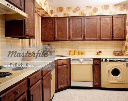 1970s KITCHEN INTERIOR WITH YELLOW APPLIANCES AND PRINT WALLPAPER Stock Photo - Rights-Managed, Image code: 846-03164722