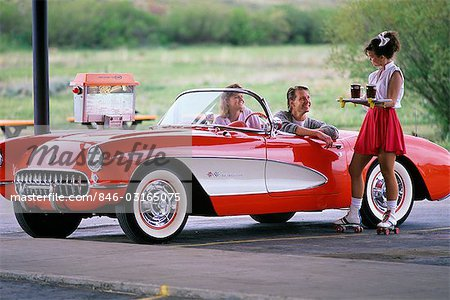 YOUNG COUPLE IN DRIVE-IN BEING SERVED DRINKS GRANBY COLORADO Stock Photo - Rights-Managed, Image code: 846-03165075