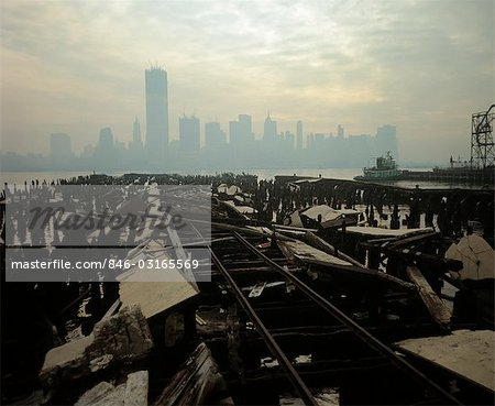 1970s SKYLINE OF DOWNTOWN MANHATTAN FROM ROTTING BROOKLYN PIER SHADOW OF WORLD TRADE CENTER UNDER CONSTRUCTION Stock Photo - Rights-Managed, Image code: 846-03165569
