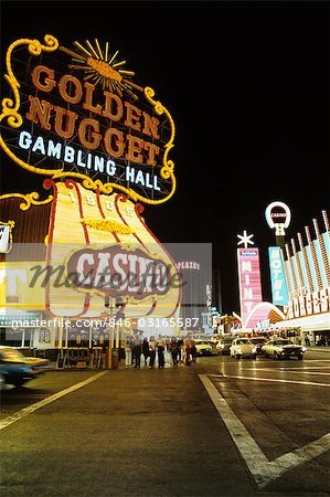 1970s FREMONT STREET DOWNTOWN LAS VEGAS NEVADA AT NIGHT WITH NEON OF GOLDEN NUGGET HORSESHOE AND MINT CASINOS Stock Photo - Rights-Managed, Image code: 846-03165587