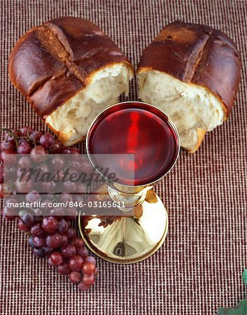 CHALICE FULL OF WINE GRAPES AND BREAD COMMUNION STILL LIFE