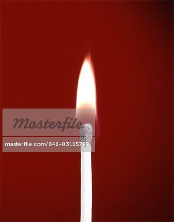 BURNING WOODEN SAFETY MATCH ON RED BACKGROUND FLAME Stock Photo - Rights-Managed, Image code: 846-03165799