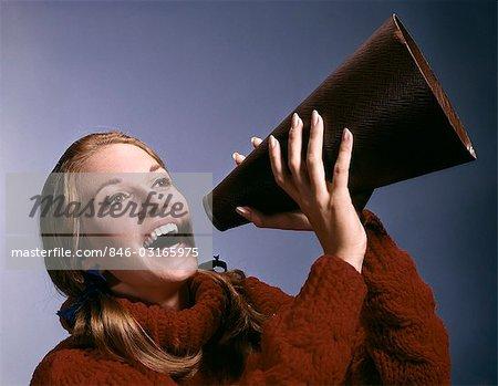 1960s PORTRAIT TEEN CHEERLEADER SHOUTING INTO MEGAPHONE