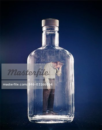 1970s SAD DEPRESSED MAN TRAPPED INSIDE GLASS BOTTLE ALCOHOLISM ALCOHOLIC ADDICTED ADDICTION Stock Photo - Rights-Managed, Image code: 846-03166064