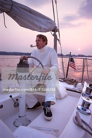 1980s CHESAPEAKE BAY MARYLAND MAN IN WHITE AT WHEEL OF SAILING BOAT Stock Photo - Rights-Managed, Image code: 846-03166236
