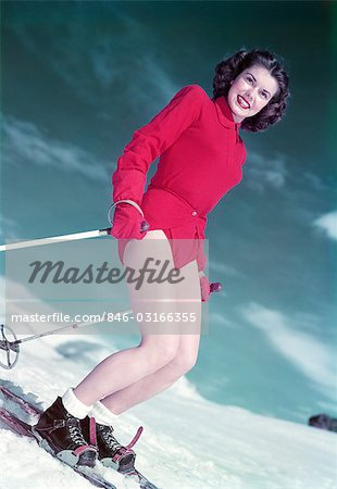 1940s 1950s SMILING WOMAN SKIING WEARING RED LEOTARD SKI OUTFIT WITH GLOVES Stock Photo - Rights-Managed, Image code: 846-03166355