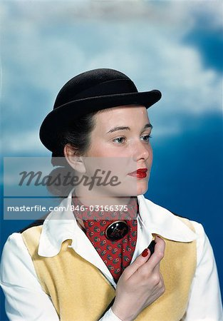 1940s 1950s PORTRAIT TEEN GIRL WEARING EQUESTRIAN OUTFIT DERBY HAT HOLDING RIDING CROP Stock Photo - Rights-Managed, Image code: 846-03166375