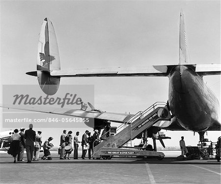 1950s PEOPLE BOARDING CONSTELLATION STYLE AIRPLANE DOUBLE TAIL OUTDOOR Stock Photo - Rights-Managed, Image code: 846-05645855