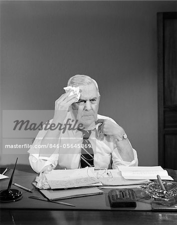1950s BUSINESSMAN SITTING AT DESK WIPING FOREHEAD WITH HANDKERCHIEF PULLING AT SHIRT COLLAR Stock Photo - Rights-Managed, Image code: 846-05645869