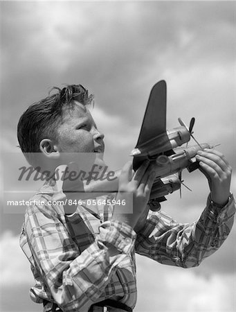 1930s - 1940s - 1950s PROFILE FRECKLE-FACED BOY HOLDING MODEL PROPELLER AIRPLANE Stock Photo - Rights-Managed, Image code: 846-05645946