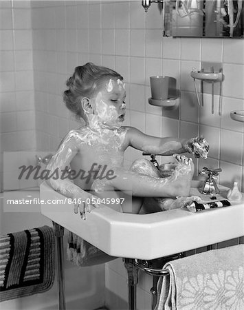 1940s GIRL SITTING IN SINK LATHERED WITH SOAP Stock Photo - Rights-Managed, Image code: 846-05645997