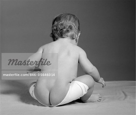 1960s BACK VIEW OF BABY SEATED WITH DIAPER COMING OFF AND BARE BOTTOM SHOWING Stock Photo - Rights-Managed, Image code: 846-05646014