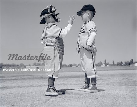 1960s BOY LITTLE LEAGUER PITCHER ARGUING WITH CATCHER Stock Photo - Rights-Managed, Image code: 846-05646067