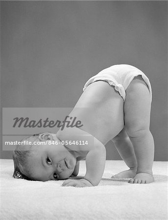 1950s SIDE VIEW OF PORTRAIT BABY IN DIAPER WITH CHEEK TO FLOOR AND BOTTOM IN AIR Stock Photo - Rights-Managed, Image code: 846-05646114