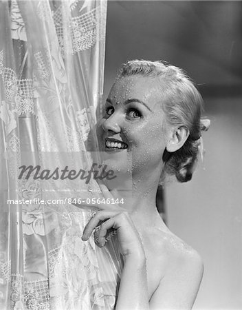 1950s PORTRAIT OF WET BLONDE PEEKING AROUND SHOWER CURTAIN Stock Photo - Rights-Managed, Image code: 846-05646144