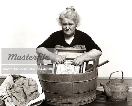 1920s - 1930s - 1940s SENIOR WOMAN WASHING CLOTHES IN OLD FASHIONED WOODEN TUB AND WASHBOARD Stock Photo - Rights-Managed, Image code: 846-05646188