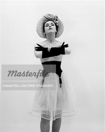 1950s WOMAN TOPLESS WEARING STRAW HAT LONG GLOVES BLACK GARTER BELT ARMS FOLDED IN FRONT Stock Photo - Rights-Managed, Image code: 846-05646365