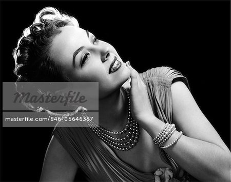 1950s GLAMOROUS WOMAN WEARING FOUR STRAND PEARL NECKLACE AND MATCHING BRACELET Stock Photo - Rights-Managed, Image code: 846-05646387