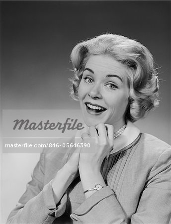 1950s - 1960s WOMAN CLASPED HAND BY CHIN WITH WISHFUL HOPING HAPPY JOYFUL FACIAL EXPRESSION Stock Photo - Rights-Managed, Image code: 846-05646390
