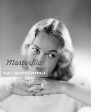 1950s PRETTY BLOND WOMAN CHIN RESTING ON HANDS LOOKING OFF TO THE SIDE Stock Photo - Rights-Managed, Image code: 846-05646396