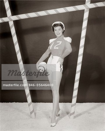 1950s - 1960s WOMAN IN SEXY FOOTBALL COSTUME AT GOALPOST Stock Photo - Rights-Managed, Image code: 846-05646400