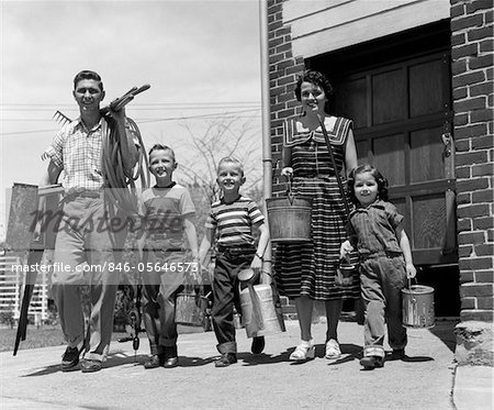 1950s FAMILY MOTHER FATHER 3 CHILDREN HAPPY SMILING CARRYING GARDENING HOME IMPROVEMENT TOOLS Stock Photo - Rights-Managed, Image code: 846-05646573