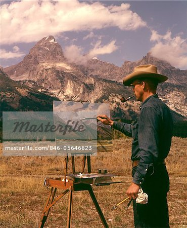 1950s - 1960s MAN ARTIST SMOKING PIPE PAINTING MOUNTAIN LANDSCAPE GRAND TETONS WYOMING Stock Photo - Rights-Managed, Image code: 846-05646623