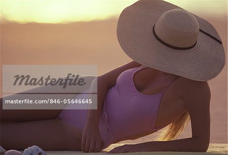 1980s WOMAN SUNBATHING WEARING LARGE STRAW HAT Stock Photo - Rights-Managed, Image code: 846-05646645