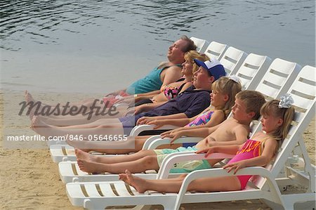 1990s FAMILY SUNBATHING NEAR WATER NOT AVAILABLE FOR POCONO RESORT USAGES Stock Photo - Rights-Managed, Image code: 846-05646655