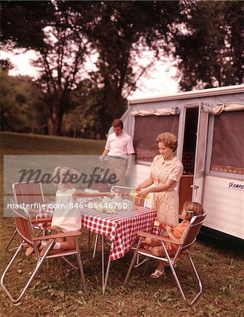 1960s FAMILY RV CAMPING FATHER GRILLING MOTHER  AND GIRLS SETTING TABLE Stock Photo - Rights-Managed, Image code: 846-05646760