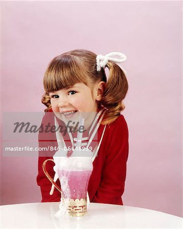 1960s - 19670s HAPPY LITTLE GIRL WITH ICE CREAM SODA STUDIO PONYTAIL Stock Photo - Rights-Managed, Image code: 846-05646939