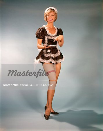 1960s WOMAN SMILING WEARING SHORT BLACK & WHITE LACE FRENCH MAID COSTUME POINTING TO SILVER TRAY Stock Photo - Rights-Managed, Image code: 846-05646952
