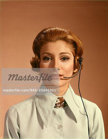1960s - 1970s PORTRAIT WOMAN TELEPHONE OPERATOR RECEPTIONIST OFFICE WORKER WEARING HEADSET Stock Photo - Rights-Managed, Image code: 846-05646961