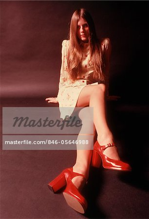 1970s WOMAN LONG AUBURN HAIR MINI SKIRT DRESS RED PLATFORM HIGH HEELED SHOES Stock Photo - Rights-Managed, Image code: 846-05646988