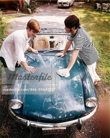 1970s TWO TEENAGED BOYS WASHING TRIUMPH SPORTS CAR  CONVERTIBLE Stock Photo - Rights-Managed, Image code: 846-05647137