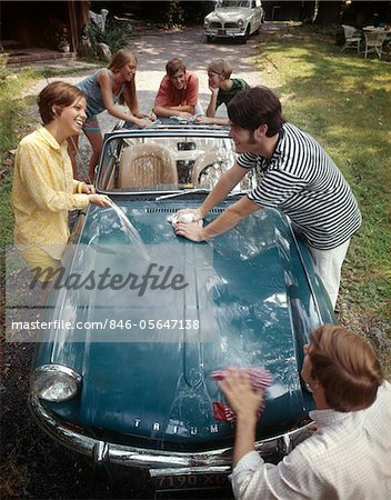 1970s TEENAGE GROUP OF 3 BOYS AND 3 GIRLS TOGETHER WASHING TRIUMPH SPITFIRE SPORTS CAR Stock Photo - Rights-Managed, Image code: 846-05647138