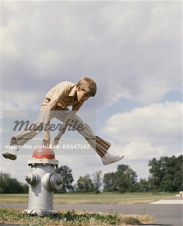 1970s BOY JUMPING OVER FIRE HYDRANT Stock Photo - Rights-Managed, Image code: 846-05647142