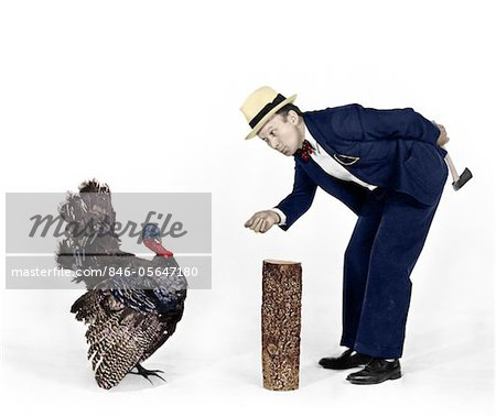 1930s - 1940s MAN CHARACTER WITH HATCHET TRYING TO CATCH A THANKSGIVING TURKEY Stock Photo - Rights-Managed, Image code: 846-05647180