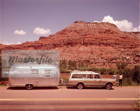 1970s STATION WAGON TRAILER RV NEW MEXICO HIGHWAY TOURIST MAN WOMAN BY MESA FORMATION AIRSTREAM Stock Photo - Rights-Managed, Image code: 846-05647233