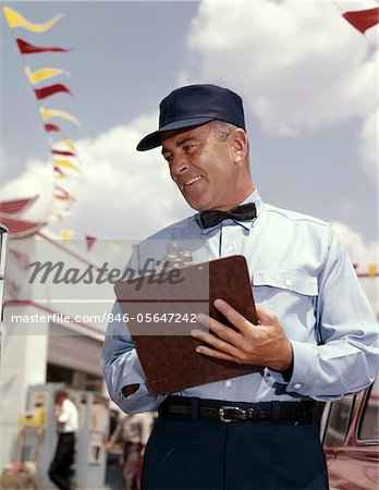 1950s - 1960s MAN SERVICE MANAGER AT AUTOMOBILE GAS AND REPAIR SERVICE STATION WRITING ON CLIPBOARD Stock Photo - Rights-Managed, Image code: 846-05647242