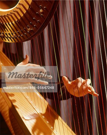 1960s MUSICAL INSTRUMENT DETAIL HANDS PLUCKING PLAYING HARP STRINGS Stock Photo - Rights-Managed, Image code: 846-05647248