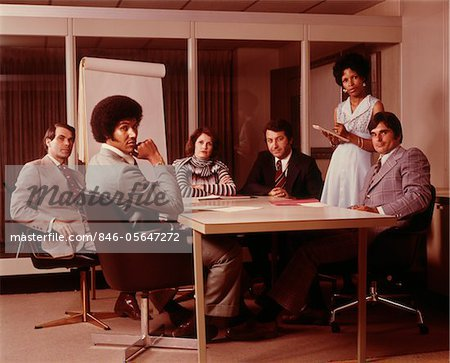1970s BUSINESS MEETING SIX SERIOUS PEOPLE SITTING AROUND CONFERENCE TABLE Stock Photo - Rights-Managed, Image code: 846-05647272
