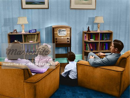 1940s - 1950s FAMILY WATCHING TV IN LIVING ROOM Stock Photo - Rights-Managed, Image code: 846-05647357