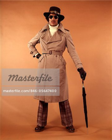 1970s AFRICAN-AMERICAN YOUNG MAN FASHION TRENCH COAT HAT SUNGLASSES DUDE COOL HIP CLOTHES Stock Photo - Rights-Managed, Image code: 846-05647400