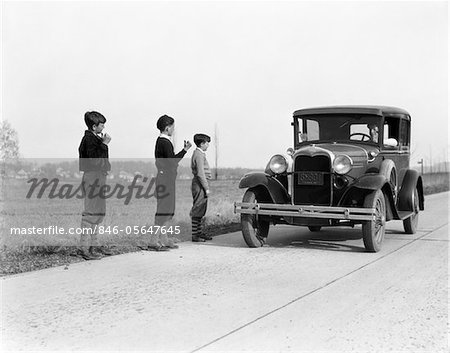 1930s - 1920s MAN DRIVING FORD MODEL A CAR 3 BOYS HITCHHIKING Stock Photo - Rights-Managed, Image code: 846-05647645