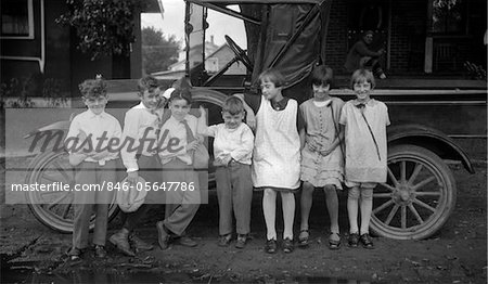 1910s CHILDREN LINED UP IN FRONT OF TRUCK FACING CAMERA Stock Photo - Rights-Managed, Image code: 846-05647786